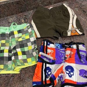3 boys Hurley and Quicksilver swim trunks
